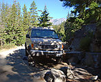 Camping - Hiding Behind Rock on the Old Road - by Icicle Creek - Sportsmobile