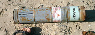 "Malarrimo Beach - Military Device - Navair phosphorus marker? - Labeled ""Notify police or military."" (1/2/2002 3:41 PM)"