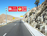 "La Rumorosa - Sign, ""EVITE ACCIDENTES - PRECAUCION RIESGO DE VOLCADURA"" - Driving East"