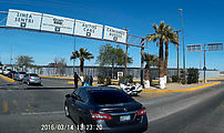 Baja - Mexicali - USA Border - Calexico II - Chaotic intersection, turning left into border complex - Police Officer