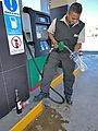 Baja - San Felipe - Filling Plastic Bottle with Gasoline