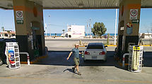 Baja - San Felipe - Gas Station - Filling Plastic Bottle with Gasoline