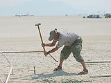 Costco Barn - Hammering Rebar (Burning Man 2002)