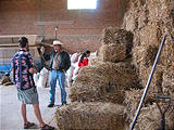 Eronga - Brian - Talking to Farmer about Using Hay Bales for Building Construction