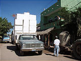 La Manzanilla - Tall Truck Going Under Xmas Decorations in front of Homestay House