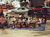 Melaque - Square at Night - This woman sold unpainted plaster figures to kids, who could paint them right there.