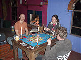 Rancho Madroño - Playing Settlers at the Casita - Geoff, Marie, Lars (photo by Lars)