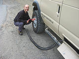 Oregon Dunes NRA - Geoff Airing Up Tires, Which Were Deflated for Driving on Sand - Sportsmobile (October 16, 2004 11:02 AM)