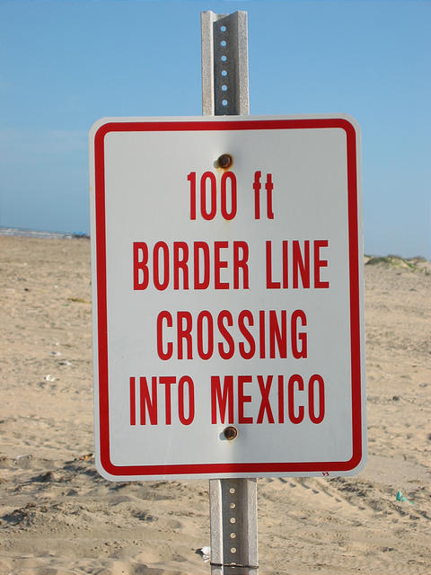 Mexican border beach sign 100 ft border line crossing into mexico