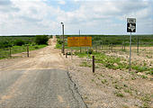 Texas - Mexican Border Road Along Rio Grande From Eagle Pass to Laredo - Where the Pavement Ends - Sign End Farm Road 1021