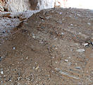 Utah - Silver Island Mountains - Hillside Cave - Layers of (dug up) dirt inside